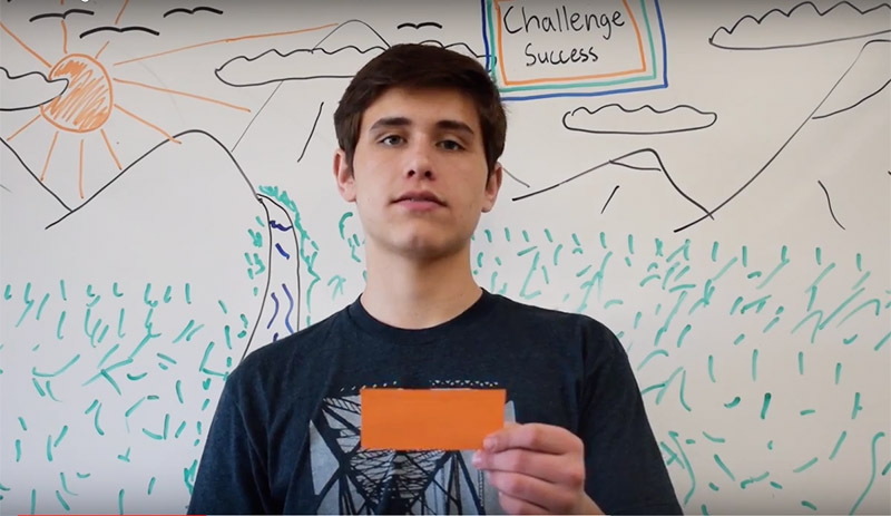 "Challenge Success Club Founder and Upper School Senior Andrew B. in Front of Whiteboard with ""I Wish..."" Notecard"