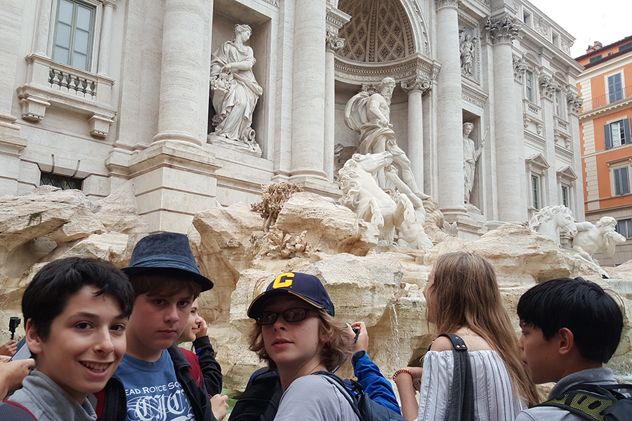 Some Middle School boys pose outside of the Trevi Fountain in Rome, Italy
